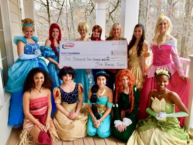 """Our first check presentation to Rally after our """"Springtime Mommy and Me Princess Tea"""""""